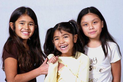 Pretty dark haired girls laughing and having fun